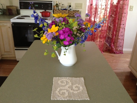 I brought the garden inside with a Farmer's Market bouquet that has thrived all week.