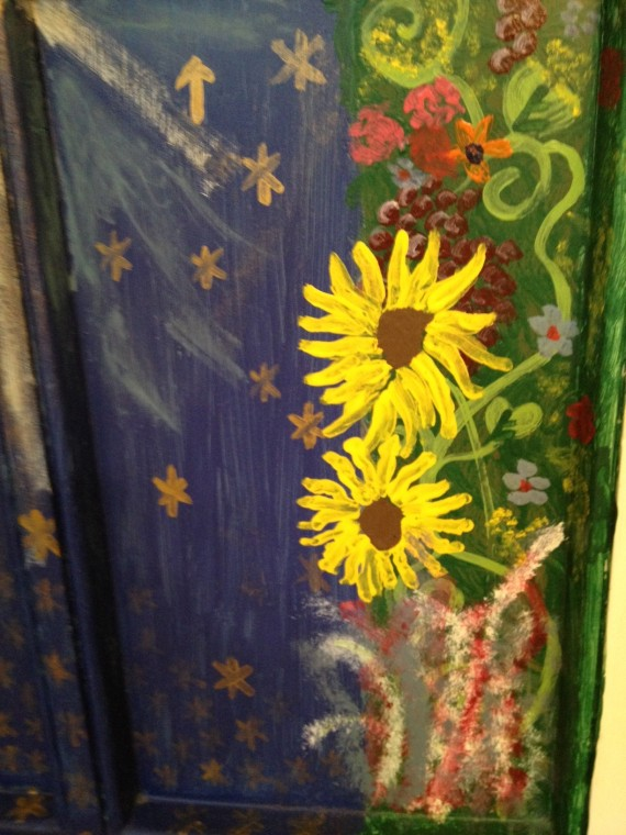 Here's the part that made me gasp. I painted this door in 2010, way before I ever had my own garden or ever thought of growing sunflowers. I have no idea what those fuzzy white, purple and bluish flowery things are underneath the sunflowers.