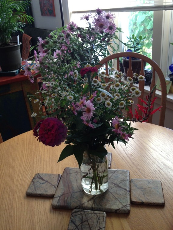"""Bouquet I made for David and me when I accidentally snapped off two zinnias gone wild. """"Fixing"""" the problem became a delight."""