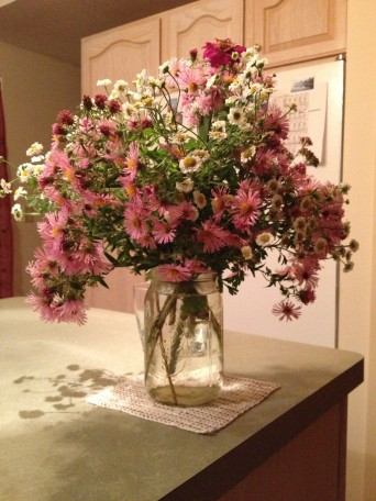 Another nearby bouquet of fall asters, feverfew, yarrow, rosemary and zinnias