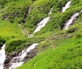 Water cascades off Glacier's Garden Wall