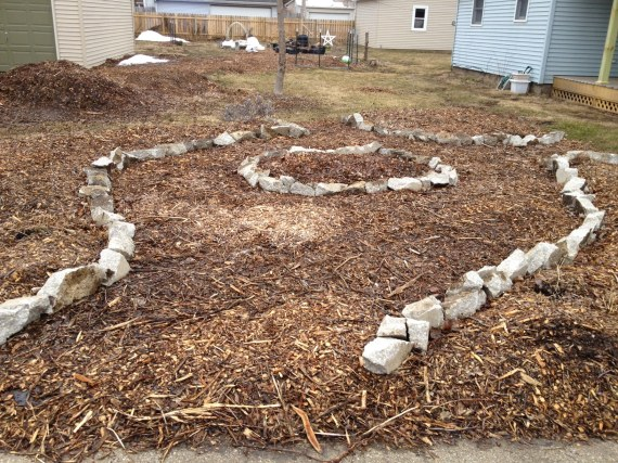 Almost finished the edging. It's a circle with three entrances wide enough for my wheelbarrow and for meandering once we have edible ornamentals to admire. You can see the last part of Mount Mulchmore towards the upper left.