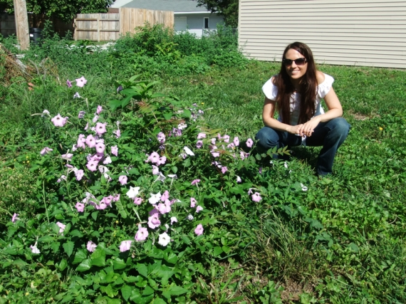 Me next to the wild petunias the day we decided to rent this place and commit to permaculturing the yard.