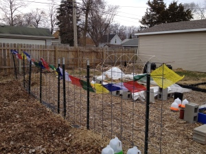New prayer flags went up yesterday -- specially made for outdoor use, unlike the faded cotton ones I finally composted.
