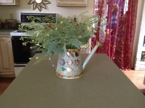 She smells sea kale down by the sea shells. (Watering can designed and crafted by sweet Tania Marie.)